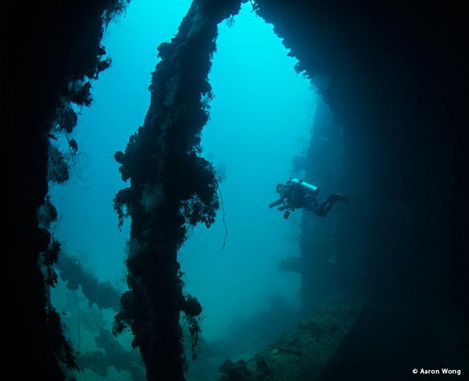 Diver inside a wreck