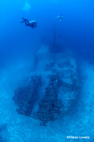 Wreck with scuba divers in Bikini Atoll