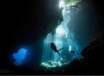 Diver diving inside a cave in Solomon Islands