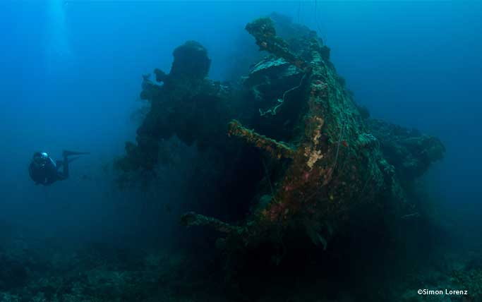 Diver next to a wreck in Palau.